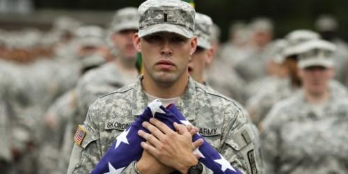 soldier hugs flag